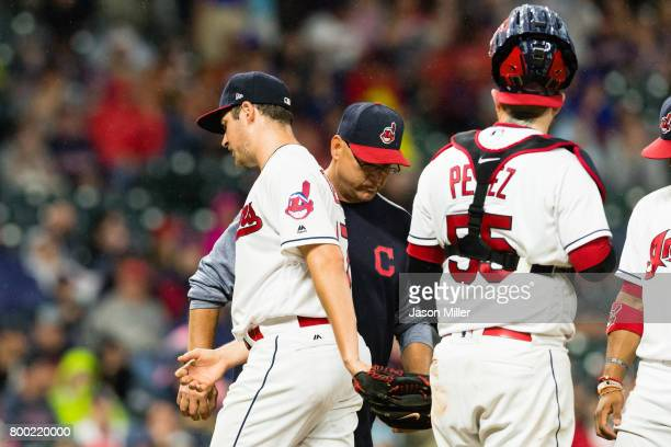 Manager Terry Francona removes starting pitcher Trevor Bauer of the Cleveland Indians from the game during the seventh inning against the Minnesota...