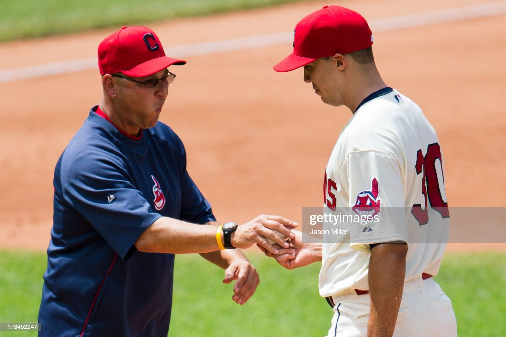 Manager <a gi-track='captionPersonalityLinkClicked' href=/galleries/search?phrase=Terry+Francona&family=editorial&specificpeople=171936 ng-click='$event.stopPropagation()'>Terry Francona</a> #17 removes starting pitcher <a gi-track='captionPersonalityLinkClicked' href=/galleries/search?phrase=Ubaldo+Jimenez&family=editorial&specificpeople=2539590 ng-click='$event.stopPropagation()'>Ubaldo Jimenez</a> #30 of the Cleveland Indians from the game during the fifth inning against the Kansas City Royals at Progressive Field on July 14, 2013 in Cleveland, Ohio.