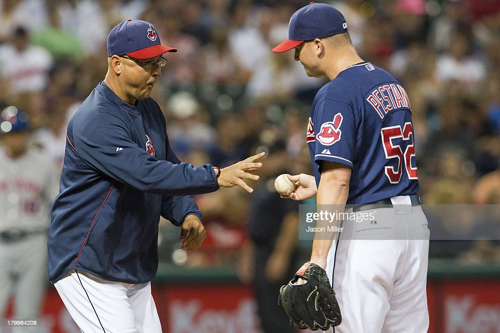 Manager <a gi-track='captionPersonalityLinkClicked' href=/galleries/search?phrase=Terry+Francona&family=editorial&specificpeople=171936 ng-click='$event.stopPropagation()'>Terry Francona</a> #17 takes relief pitcher <a gi-track='captionPersonalityLinkClicked' href=/galleries/search?phrase=Vinnie+Pestano&family=editorial&specificpeople=4583581 ng-click='$event.stopPropagation()'>Vinnie Pestano</a> #52 of the Cleveland Indians out of the game after Pestano gave up three runs during the sixth inning against the New York Mets at Progressive Field on September 7, 2013 in Cleveland, Ohio.