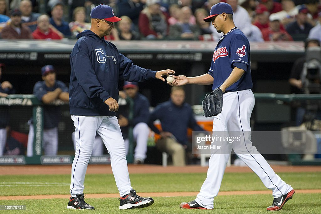 Manager Terry Francona #17 takes the ball from starting pitcher Carlos Carrasco #59 of the Cleveland Indians during the fourth inning after Carrasdo was ejected for throwing at Kevin Youkilis #36 of the New York Yankees at Progressive Field on April 9, 2013 in Cleveland, Ohio.