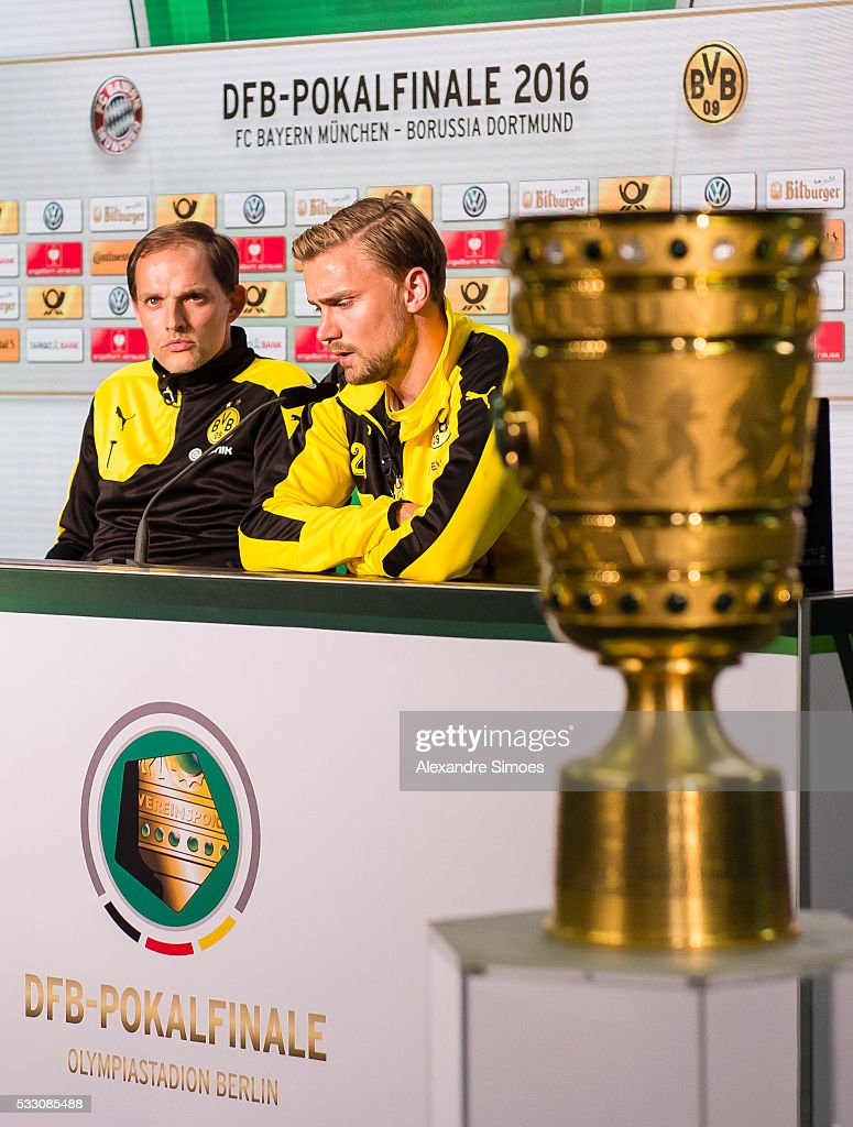 Manager <a gi-track='captionPersonalityLinkClicked' href=/galleries/search?phrase=Thomas+Tuchel&family=editorial&specificpeople=5927236 ng-click='$event.stopPropagation()'>Thomas Tuchel</a> and <a gi-track='captionPersonalityLinkClicked' href=/galleries/search?phrase=Marcel+Schmelzer&family=editorial&specificpeople=5443925 ng-click='$event.stopPropagation()'>Marcel Schmelzer</a> of Borussia Dortmund during press conference prior to the DFB Cup Final 2016 match against FC Bayern Muenchen at Olympiastadion on May 20, 2016 in Berlin, Germany.
