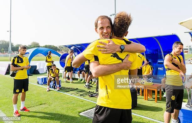 Manager Thomas Tuchel welcomes PierreEmerick Aubameyang in a training session during Borussia DortmundÕs training camp at Dubai Nad Al Sheba Sports...