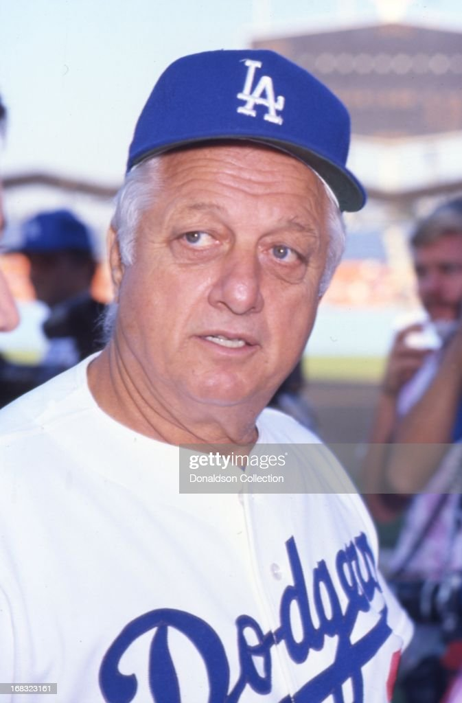Manager Tommy Lasorda of the Los Angeles Dodgers poses for a portrait on the field at Dodgers Stadium in 1986 in Los Angeles California
