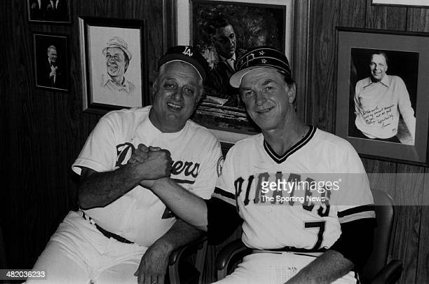 Manager Tommy Lasorda of the Los Angeles Dodgers shakes hands with Pirate's manager Chuck Tanner circa 1980s