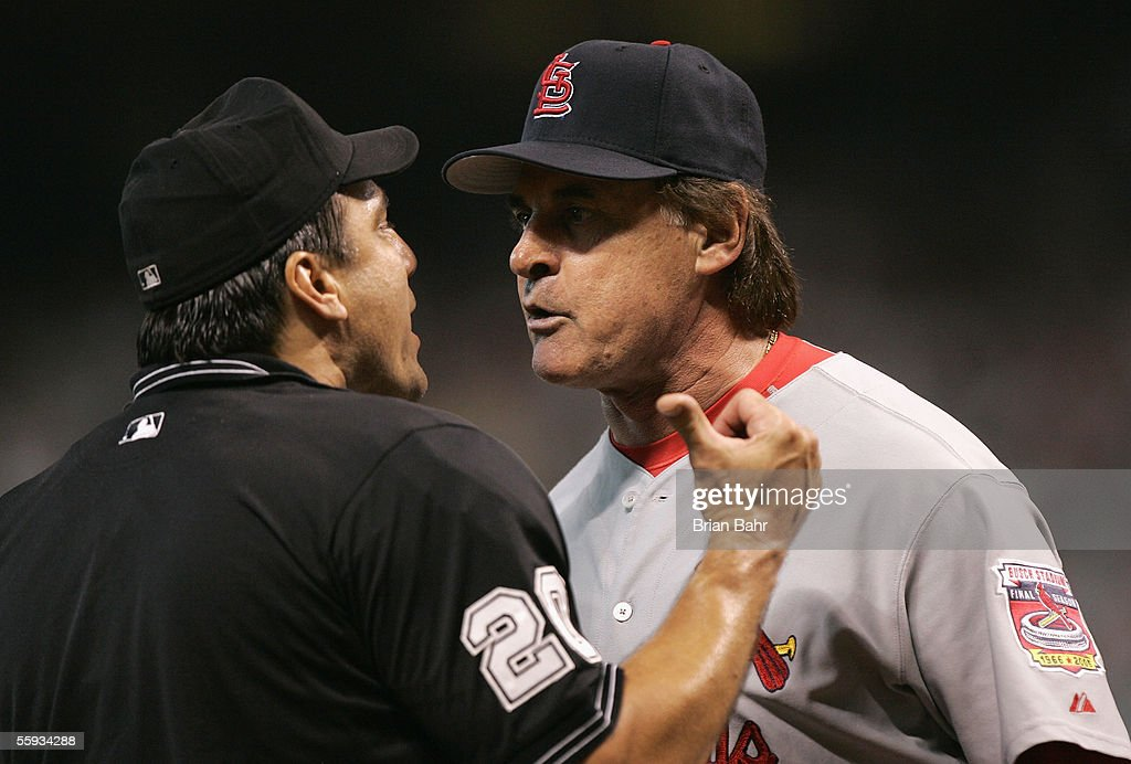 Manager Tony La Russa of the St Louis Cardinals argues with home plate umpire Phil Cuzzi after being thrown out of Game Four of the National League...