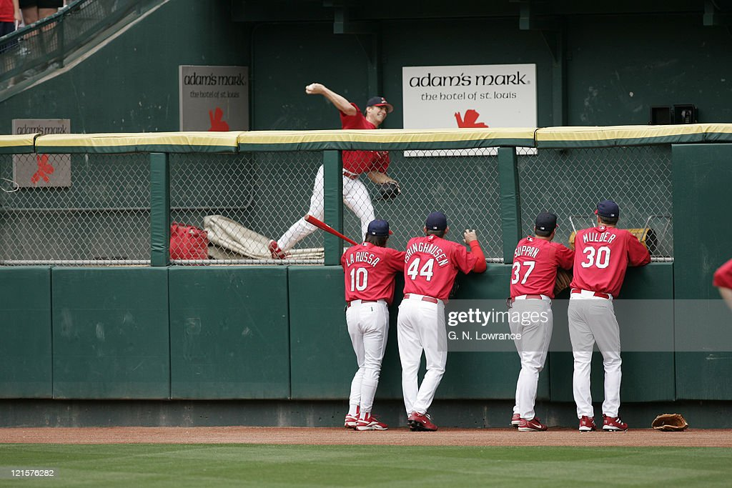 Manager Tony LaRussa (#10) and other members of the St. Louis Cardinals watch starting pitcher <a gi-track='captionPersonalityLinkClicked' href=/galleries/search?phrase=Chris+Carpenter+-+Baseball+Player&family=editorial&specificpeople=208139 ng-click='$event.stopPropagation()'>Chris Carpenter</a> warm up prior to a game against the Washington Nationals at Busch Stadium in St. Louis, Mo. on May 29, 2005. Washington won 3-2.