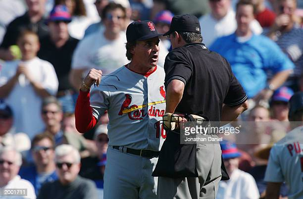 Manager Tony LaRussa of the St Louis Cardinals argues with home plate umpire Mike Winters after being tossed from the game by Winters for arguing a...