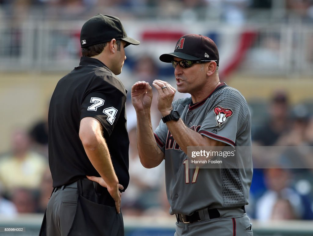 Manager Torey Lovullo #17 of the Arizona Diamondbacks argues with home plate umpire John Tumpane #74 after being ejected from the game against the Minnesota Twins during the seventh inning on August 20, 2017 at Target Field in Minneapolis, Minnesota. The Twins defeated the Diamondbacks 12-5.
