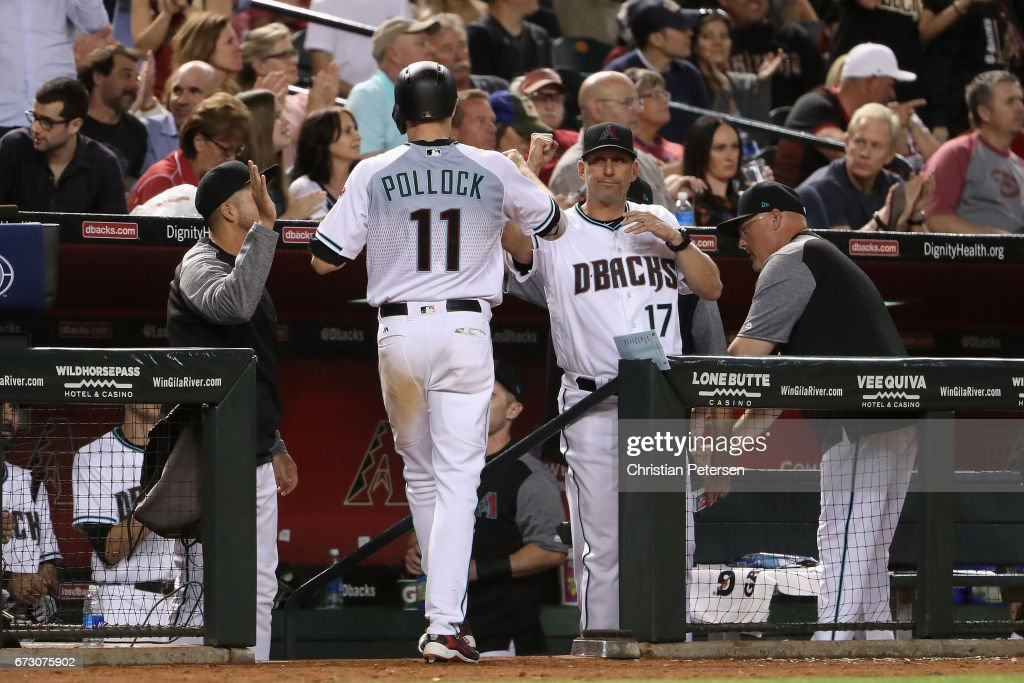 Manager Torey Lovullo #17 of the Arizona Diamondbacks high fives A.J. Pollock #11 after scoring against the San Diego Padres during the sixth inning of the MLB game at Chase Field on April 25, 2017 in Phoenix, Arizona.