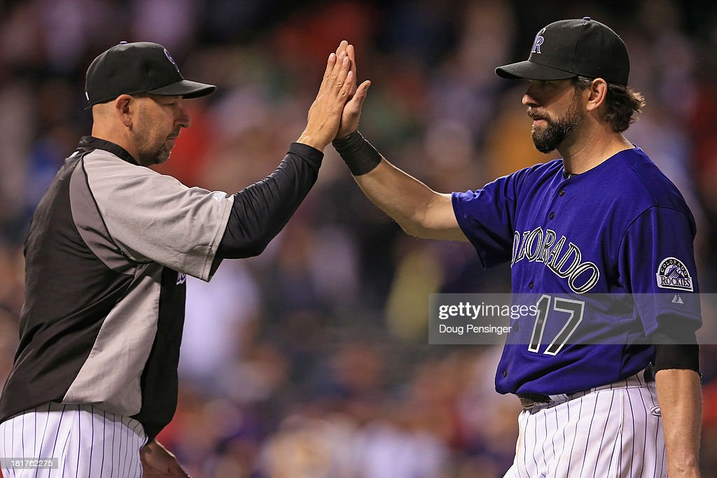 Manager <a gi-track='captionPersonalityLinkClicked' href=/galleries/search?phrase=Walt+Weiss&family=editorial&specificpeople=239045 ng-click='$event.stopPropagation()'>Walt Weiss</a> #22 of the Colorado Rockies and <a gi-track='captionPersonalityLinkClicked' href=/galleries/search?phrase=Todd+Helton&family=editorial&specificpeople=200735 ng-click='$event.stopPropagation()'>Todd Helton</a> #17 of the Colorado Rockies celebrate their 8-3 victory over the Boston Red Sox at Coors Field on September 24, 2013 in Denver, Colorado.