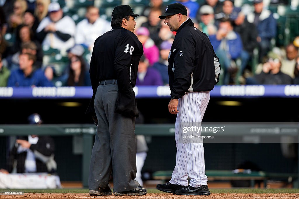 Manager Walt Weiss of the Colorado Rockies argues a call with home plate umpire Phil Cuzzi during a game against the New York Yankees at Coors Field on May 9, 2013 in Denver, Colorado. The Yankees defeated the Rockies 3-1 to win the series.