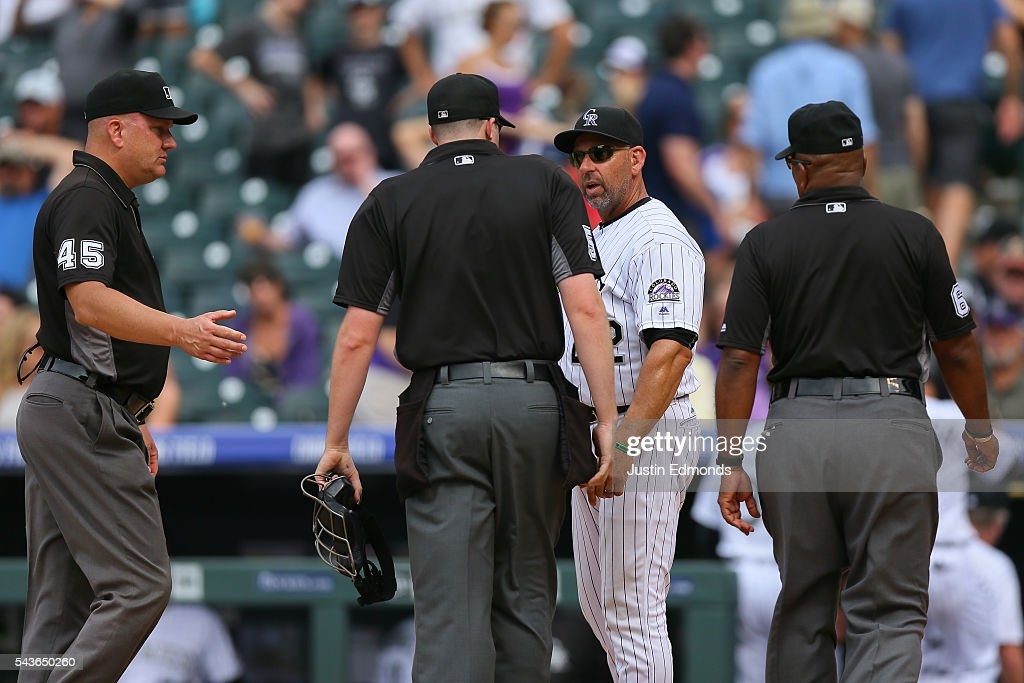 Manager Walt Weiss of the Colorado Rockies argues the final out of the game with umpires Jeff Nelson Nic Lentz and Laz Diaz after the Blue Jays...