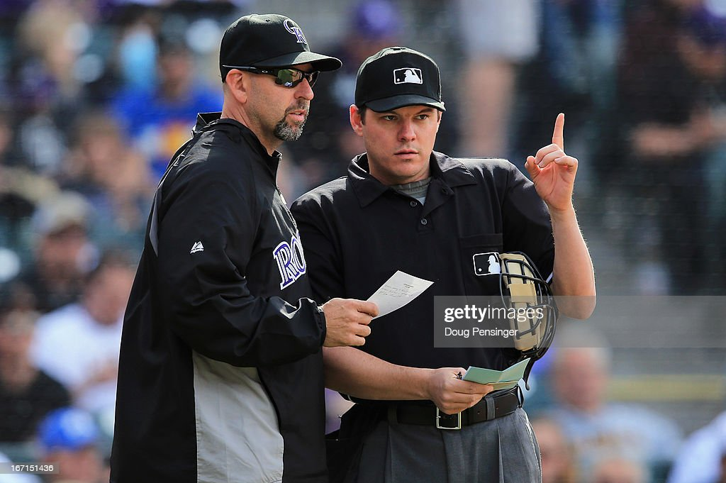 Manager Walt Weiss #22 of the Colorado Rockies delivers a lineup change to homeplate umpire Chad Fairchild when he removed starting pitcher Juan Nicasio #44 of the Colorado Rockies from the game against the Arizona Diamondbacks in the fifth inning at Coors Field on April 21, 2013 in Denver, Colorado. The Diamondbacks defeated the Rockies 5-4.