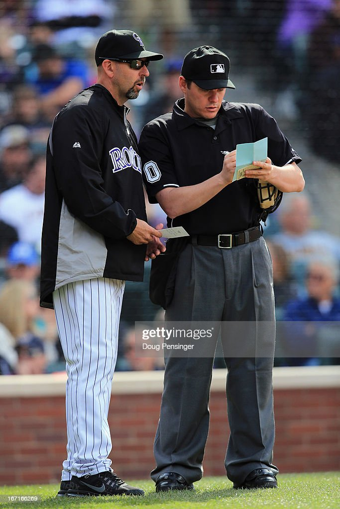 Manager Walt Weiss #22 of the Colorado Rockies delivers a lineup change to homeplate umpire D.J. Reyburn #70 against the Arizona Diamondbacks at Coors Field on April 21, 2013 in Denver, Colorado. The Diamondbacks defeated the Rockies 5-4.