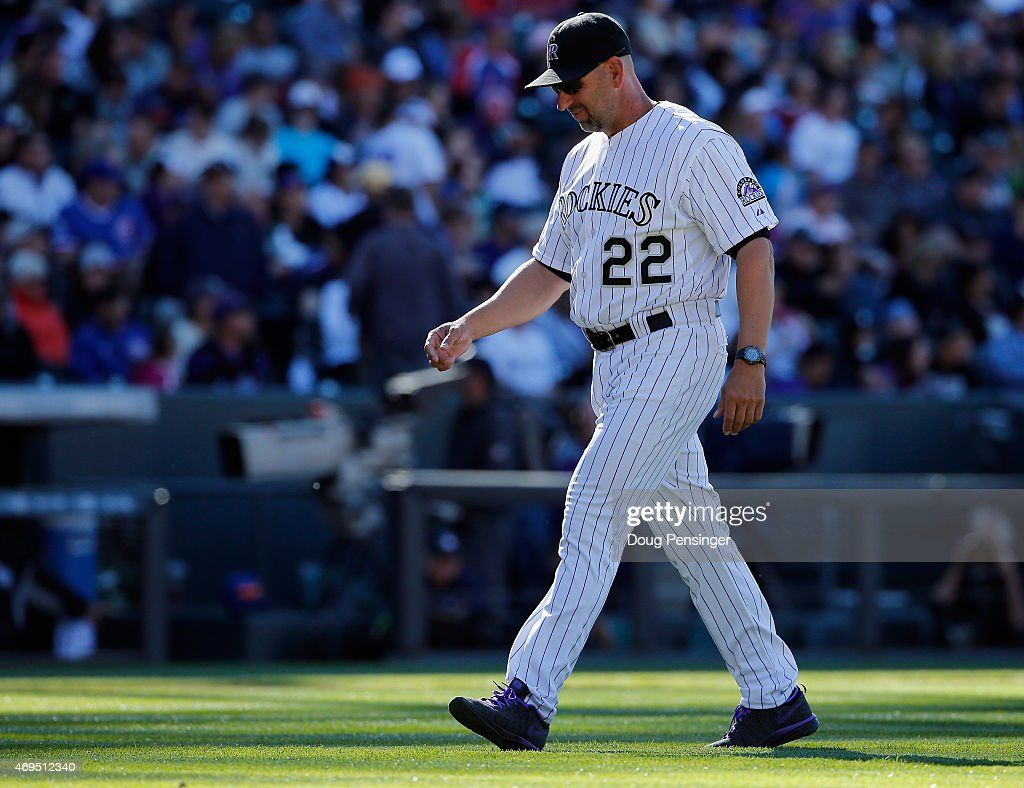 Manager Walt Weiss #22 of the Colorado Rockies returns to the dugout after making a pitching change against the Chicago Cubs at Coors Field on April 12, 2015 in Denver, Colorado. The Cubs defeated the Rockies 6-5.