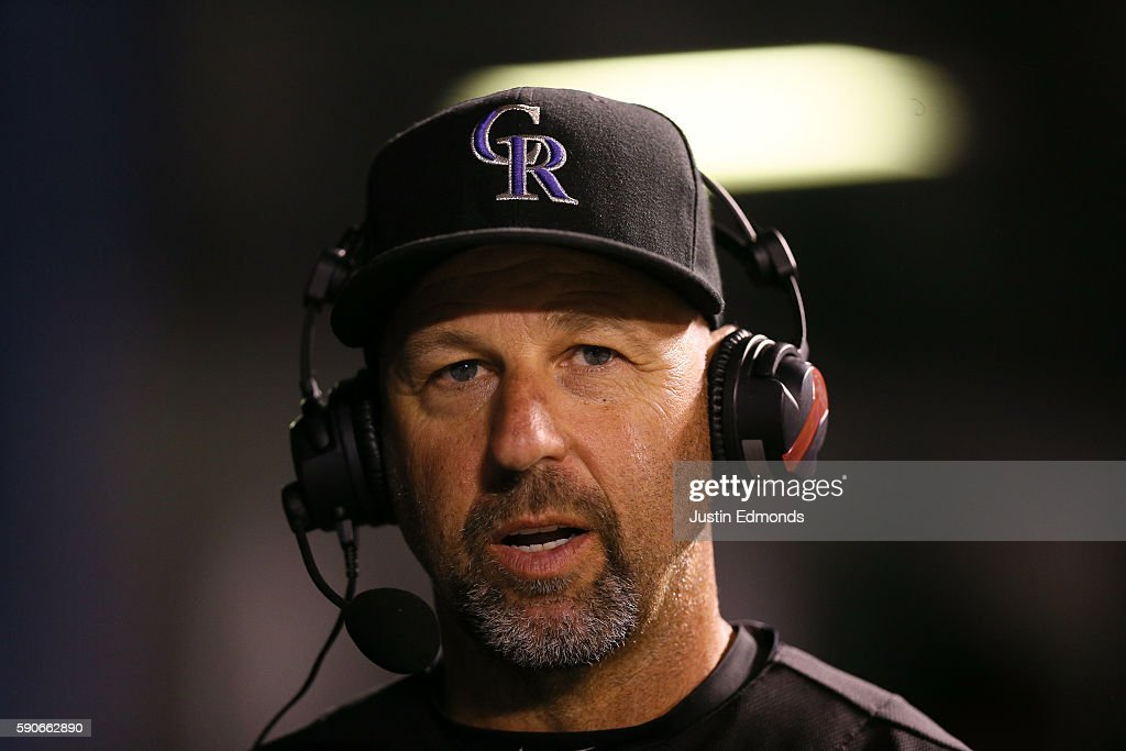 Manager Walt Weiss of the Colorado Rockies speaks with the broadcast team during the fourth inning against the Washington Nationals at Coors Field on August 16, 2016 in Denver, Colorado.