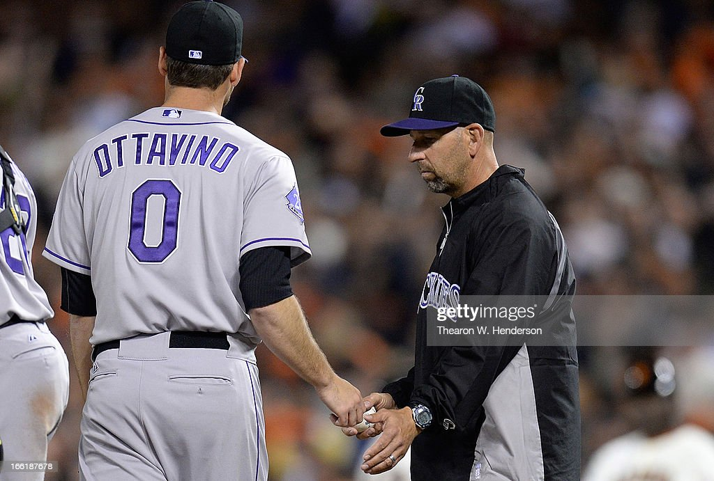 Manager <a gi-track='captionPersonalityLinkClicked' href=/galleries/search?phrase=Walt+Weiss&family=editorial&specificpeople=239045 ng-click='$event.stopPropagation()'>Walt Weiss</a> #22 of the Colorado Rockies takes the ball from Adam Ottavino #0, taking Ottavino out of the game against the San Francisco Giants in the six inning at AT&T Park on April 9, 2013 in San Francisco, California.