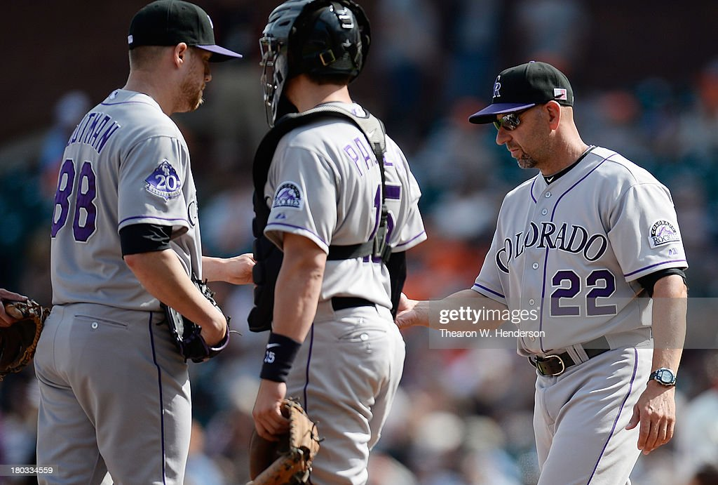 Manager <a gi-track='captionPersonalityLinkClicked' href=/galleries/search?phrase=Walt+Weiss&family=editorial&specificpeople=239045 ng-click='$event.stopPropagation()'>Walt Weiss</a> #22 of the Colorado Rockies takes the ball from pitcher <a gi-track='captionPersonalityLinkClicked' href=/galleries/search?phrase=Josh+Outman&family=editorial&specificpeople=4900182 ng-click='$event.stopPropagation()'>Josh Outman</a> #88 taking Outman out of the game in the seventh inning against the San Francisco Giants at AT&T Park on September 11, 2013 in San Francisco, California. Outman started the inning in relief for the Rockies.