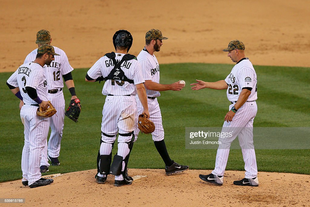 Manager <a gi-track='captionPersonalityLinkClicked' href=/galleries/search?phrase=Walt+Weiss&family=editorial&specificpeople=239045 ng-click='$event.stopPropagation()'>Walt Weiss</a> of the Colorado Rockies takes the baseball from starting pitcher Chad Bettis #35 of the Colorado Rockies and removes him from the game in the fourth inning against the Cincinnati Reds at Coors Field on May 30, 2016 in Denver, Colorado.