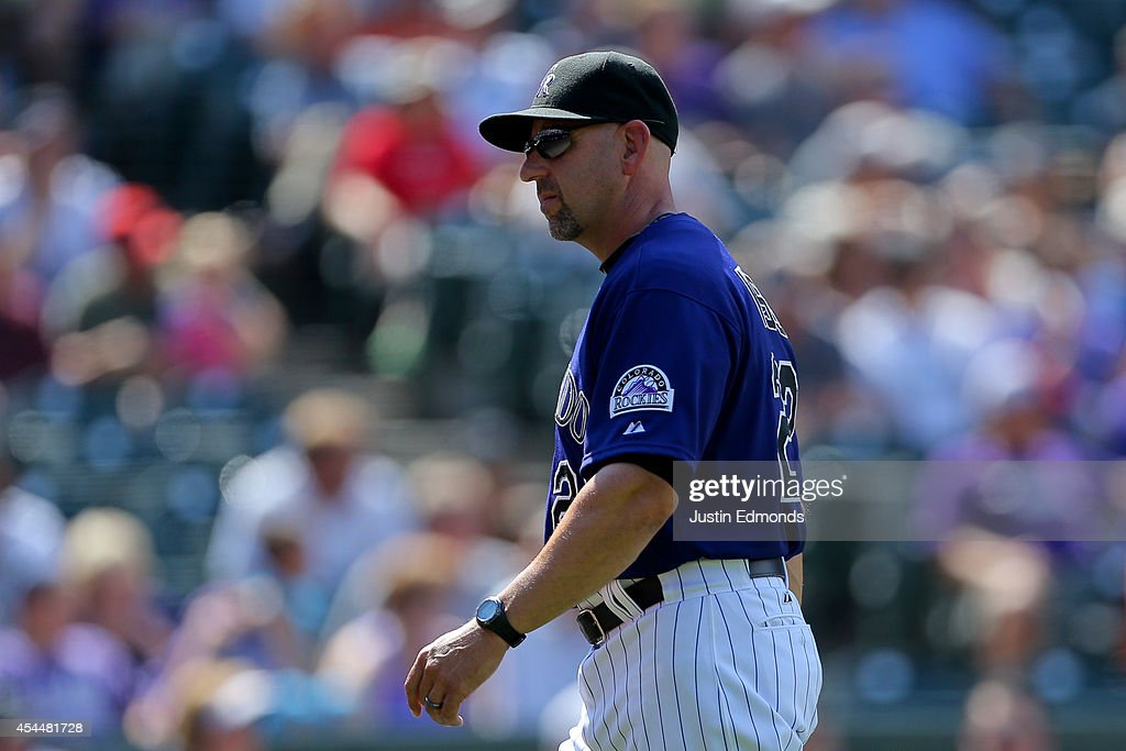 Manager <a gi-track='captionPersonalityLinkClicked' href=/galleries/search?phrase=Walt+Weiss&family=editorial&specificpeople=239045 ng-click='$event.stopPropagation()'>Walt Weiss</a> of the Colorado Rockies walks on the field after removing a pitcher from the game during the eighth inning against the San Francisco Giants at Coors Field on September 1, 2014 in Denver, Colorado. The teams were resuming a game previously suspended in the sixth inning on May 22 due to rain. The Giants defeated the Rockies 4-2.