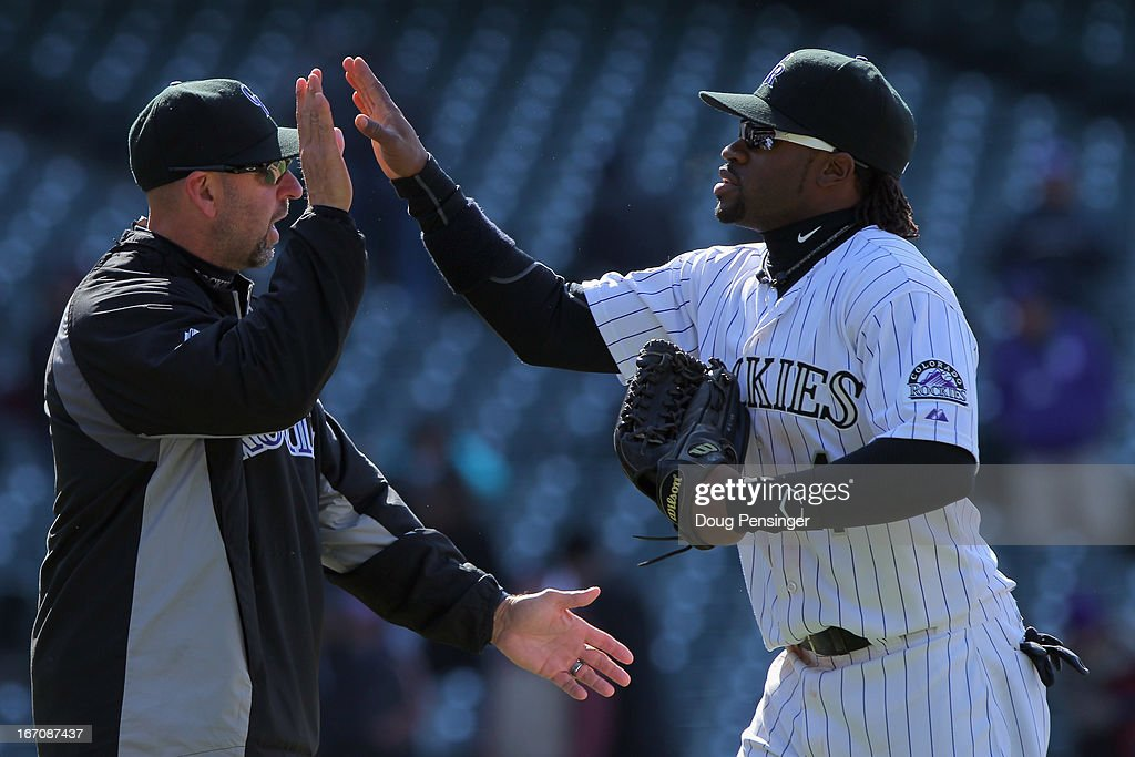 Manager <a gi-track='captionPersonalityLinkClicked' href=/galleries/search?phrase=Walt+Weiss&family=editorial&specificpeople=239045 ng-click='$event.stopPropagation()'>Walt Weiss</a> #22 of the Colorado Rockies welcomed Eric Young Jr. #1 of the Colorado Rockies off the field as they celebrate their 11-3 victory over the New York Mets at Coors Field on April 18, 2013 in Denver, Colorado.
