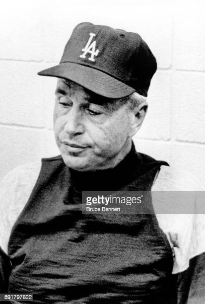 Manager Walter Alston of the Los Angeles Dodgers sits dejected in the clubhouse after losing to the St Louis Cardinals on September 28 1966 at Busch...