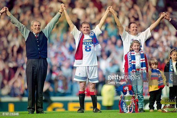 Manager Walter Smith Paul Gascoigne and Trevor Steven celebrate after Rangers had won their eighth title in a row after the Scottish Premiership...