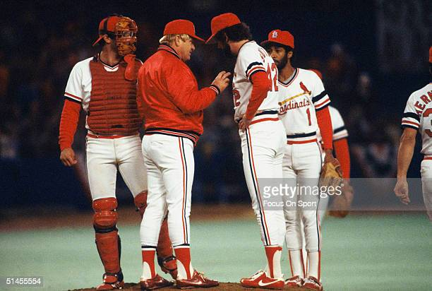 Manager Whitey Herzog of the St Louis Cardinals talks to pitcher Bruce Sutter on the mound during the World Series against the Milwaukee Brewers at...