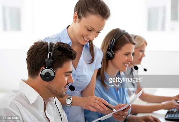 Manager with group of call center operators.