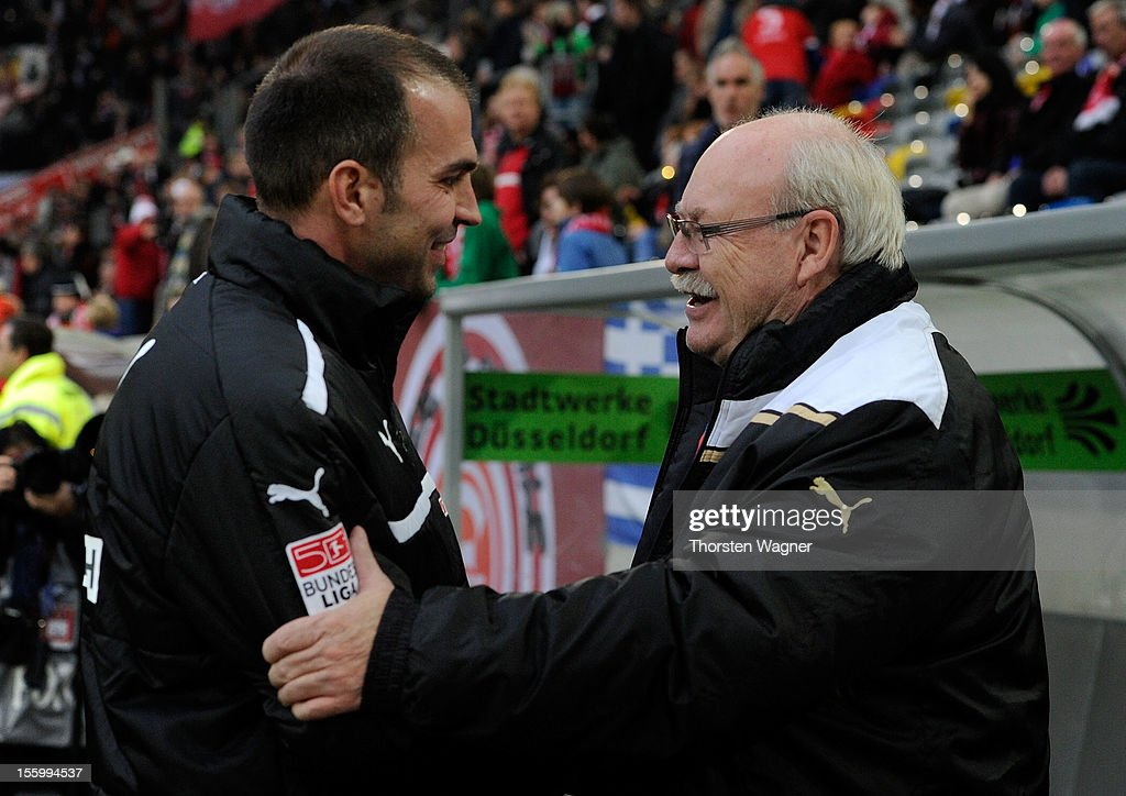Manager Wolf Werner (R) of Duesseldorf shake hands with <a gi-track='captionPersonalityLinkClicked' href=/galleries/search?phrase=Markus+Babbel&family=editorial&specificpeople=220735 ng-click='$event.stopPropagation()'>Markus Babbel</a> (R) of Hoffenheim prior to the Bundesliga match between Fortuna Duesseldorf and TSG 1899 Hoffenheim at Esprit-Arena on November 10, 2012 in Duesseldorf, Germany.