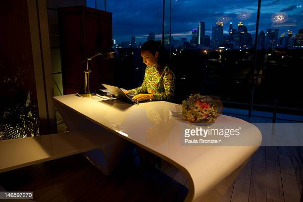 A manager works at the concierge desk in the lobby of the new Sofitel hotel June 20 2012 in Bangkok The hotel opened 3 months ago as a new design...