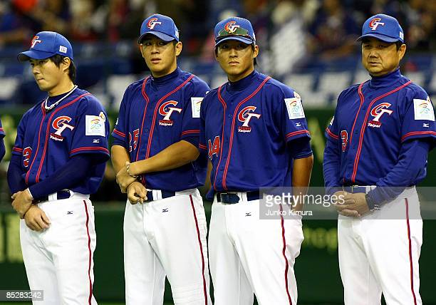 Manager Yeh ChihHsien of Team Chinese Taipei and players line up for the national anthem during Game 3 of the 2009 World Baseball Classic Pool A...