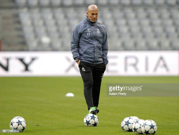 Manager Zinedine Zidane looks on during a Real Madrid training session ahead of their UEFA Champions League QuarterFinal match against Bayern...