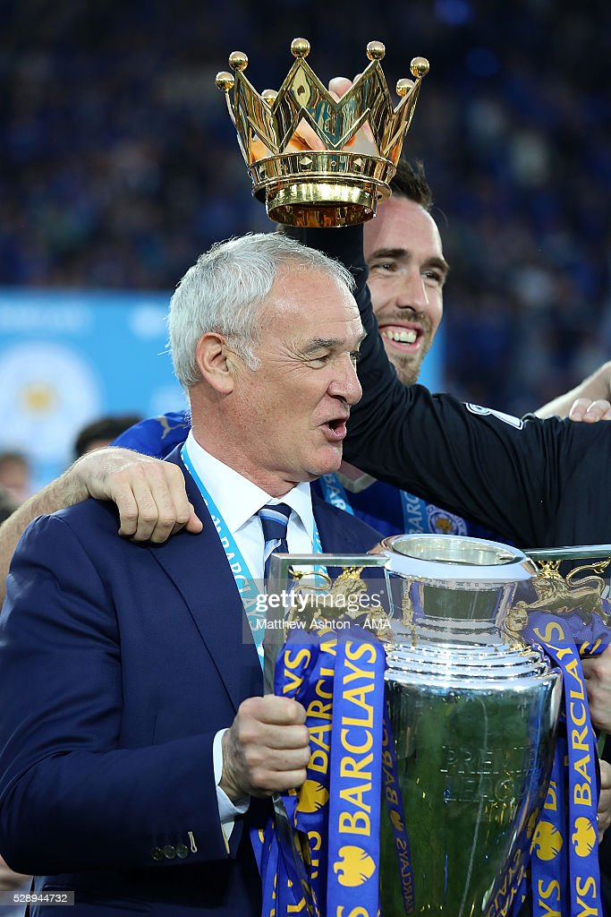 Manager/Head Coach of Leicester City Claudio Ranieri holds the Premier League Trophy as Leicester City celebrate becoming Premier League Champions...