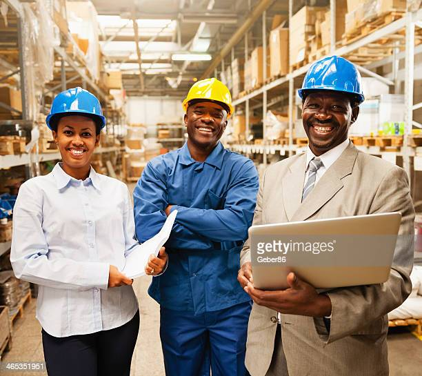 Managers and workers in warehouse