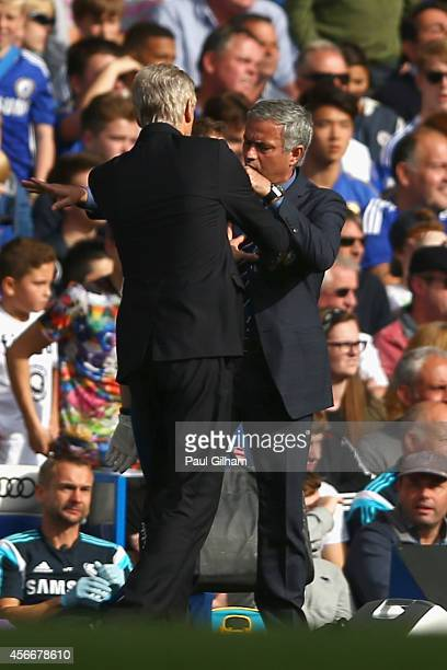 Managers Arsene Wenger of Arsenal and Jose Mourinho manager of Chelsea clash during the Barclays Premier League match between Chelsea and Arsenal at...