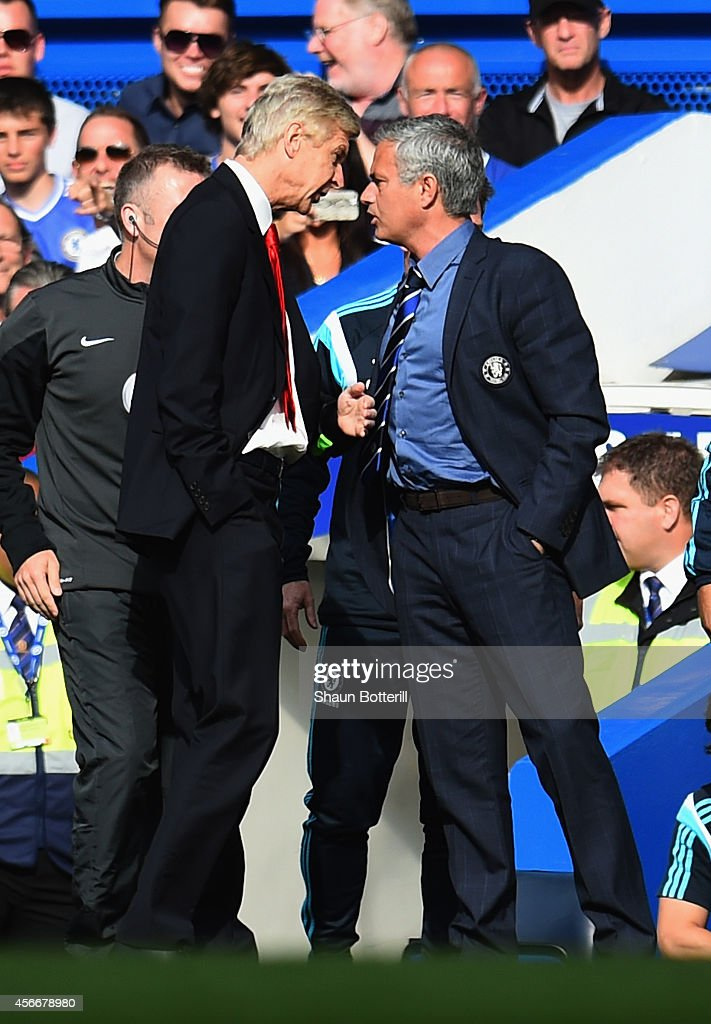 Managers <a gi-track='captionPersonalityLinkClicked' href=/galleries/search?phrase=Arsene+Wenger&family=editorial&specificpeople=171184 ng-click='$event.stopPropagation()'>Arsene Wenger</a> of Arsenal and Jose Mourinho manager of Chelsea clash during the Barclays Premier League match between Chelsea and Arsenal at Stamford Bridge on October 4, 2014 in London, England.