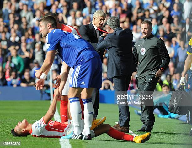 Managers Arsene Wenger of Arsenal and Jose Mourinho of Chelsea clash after a foul on Arsenal's Alexis Sanchez during the Barclays Premier League...