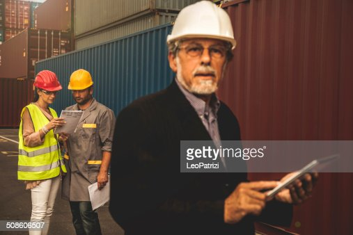 Managers at commercial dock : Stock Photo