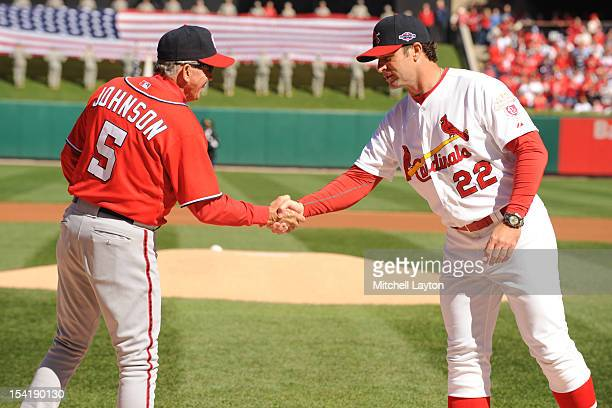 Managers Davey Johnson of the Washington Nationals and Mike Methany of the St Louis Cardinals shake hands before Game One of the National League...