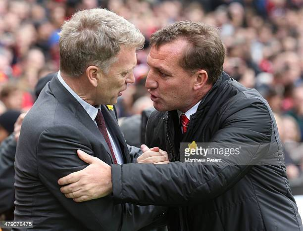 Managers David Moyes of Manchester United and Brendan Rodgers of Liverpool shakes hands ahead of the Barclays Premier League match between Manchester...