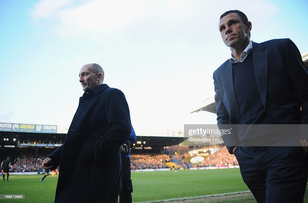 Managers Ian Holloway of Palace and Gus Poyet of Brighton walk out onto the pitch during the npower Championship Play Off Semi Final, First Leg at Selhurst Park on May 10, 2013 in London, England.
