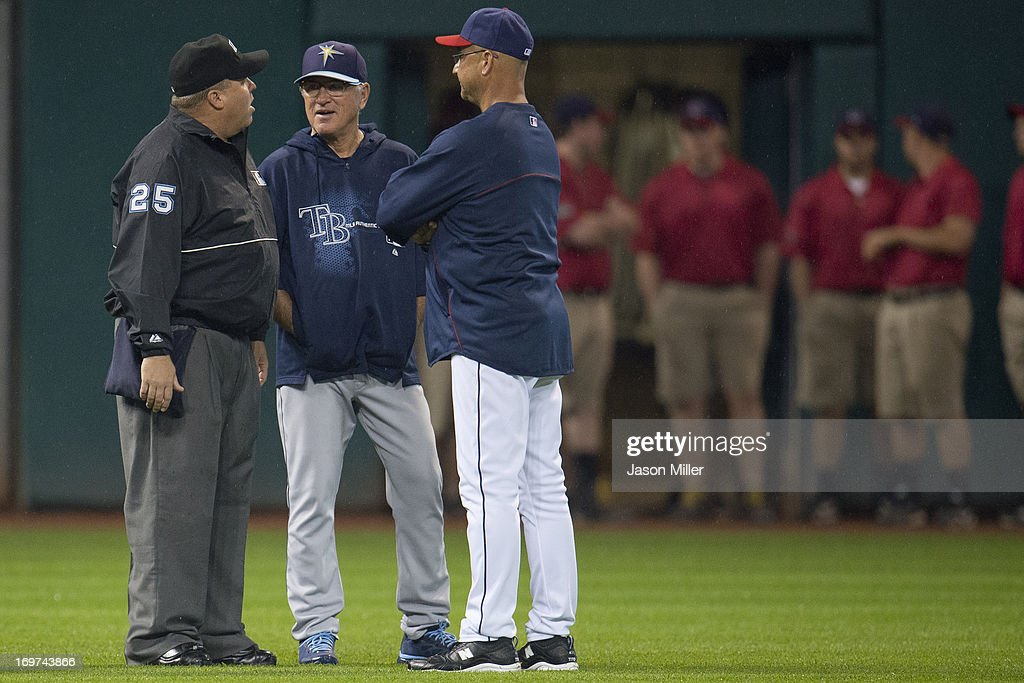 Managers <a gi-track='captionPersonalityLinkClicked' href=/galleries/search?phrase=Joe+Maddon&family=editorial&specificpeople=568433 ng-click='$event.stopPropagation()'>Joe Maddon</a> #70 of the Tampa Bay Rays and <a gi-track='captionPersonalityLinkClicked' href=/galleries/search?phrase=Terry+Francona&family=editorial&specificpeople=171936 ng-click='$event.stopPropagation()'>Terry Francona</a> #17 of the Cleveland Indians discussing the weather with umpire Fieldin Culbreth #25 during a rain delay at Progressive Field on May 31, 2013 in Cleveland, Ohio.