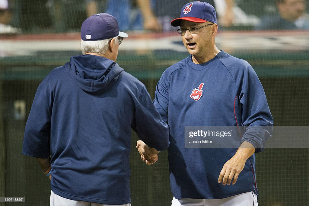 Managers <a gi-track='captionPersonalityLinkClicked' href=/galleries/search?phrase=Joe+Maddon&family=editorial&specificpeople=568433 ng-click='$event.stopPropagation()'>Joe Maddon</a> #70 of the Tampa Bay Rays and <a gi-track='captionPersonalityLinkClicked' href=/galleries/search?phrase=Terry+Francona&family=editorial&specificpeople=171936 ng-click='$event.stopPropagation()'>Terry Francona</a> #17 of the Cleveland Indians shake hands before discussing the weather during a rain delay at Progressive Field on May 31, 2013 in Cleveland, Ohio.