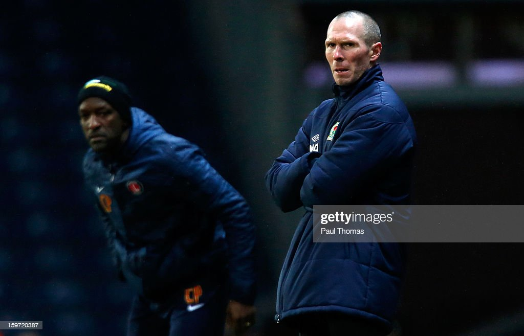 Managers Michael Appleton (R) of Blackburn and Chris Powell of Charlton on the touchline during the npower Championship match between Blackburn Rovers and Charlton Athletic at Ewood Park on January 19, 2013 in Blackburn, England.