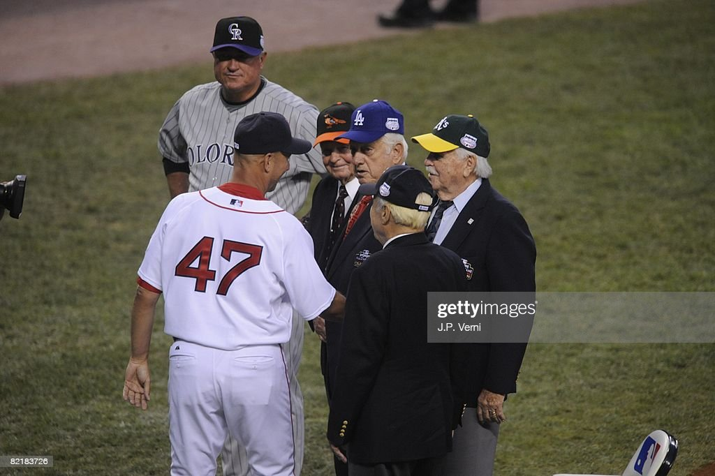 Managers Terry Francona #47 of the Boston Red Sox and Clint Hurdle of the Colorado Rockies greet Hall of Famers Earl Weaver, Tommy Lasorda, Dick Williams and Lee McPhail, Jr. before the 79th MLB All-Star Game at the Yankee Stadium in the Bronx, New York on July 15, 2008. The American League defeated the National League 4-3.