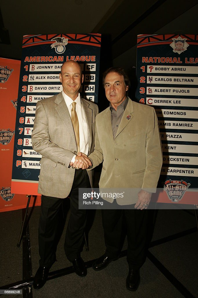 Managers Terry Francona of the Boston Red Sox (left) and Tony LaRussa of the St. Louis Cardinals shake hands at the press conference for the 2005 MLB All-Star Game during All-Star Week in Detroit, MI.