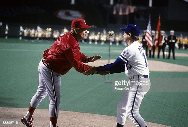 Managers Whitey Herzog of the St Louis Cardinals and Dick Howser of the Kansas City Royals shake hands prior to the start of a World Series game...