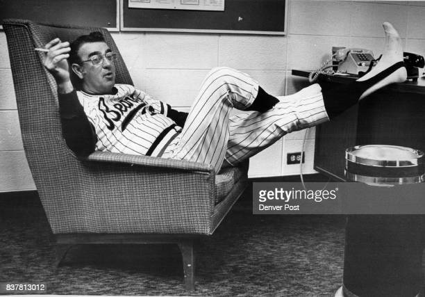 Managing a Baseball Team can be Hard Work Sometimes Denver Bears manager Loren Babe mulls over problems like the rain outside in comfort of clubhouse...