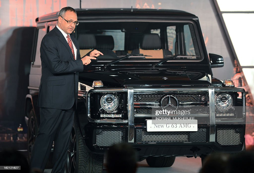 Managing Director and CEO, Mercedes-Benz India, Eberhard Kern speaks after unveiling the the new Mercedes-Benz G63 AMG premium sports utility vehicle (SUV) in Mumbai on February 19, 2013. The G 63 AMG sports a supercharged 5.5-litre V8-engine delivering 400 kw@5500rpm; 760 nm of torque @5000 rpm; 0-100 in 5.4s. AFP PHOTO/Indranil MUKHERJEE